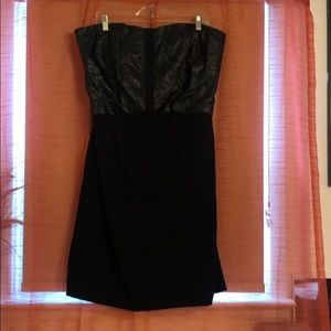 Strapless dress with faux leather trim.